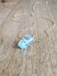 Aquamarine Necklace Made to order- aquamarine pendent will be similar to those pictured with beautiful blues and wonderful facets. Please note these stones are organically cut and can contain naturally occurring flaws, marks and things that naturally occur in aquamarine. We only use the very best stones and things that we would wear ourselves. These stones are incredibly beautiful and unique. Raw look- beautiful blue faceted piece of Aquamarine paired on a dainty 14k gold filled chain or…