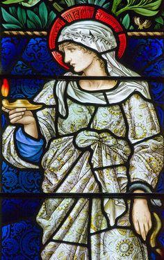 Faith. Detail from a window by Burne Jones in Buscot parish church.