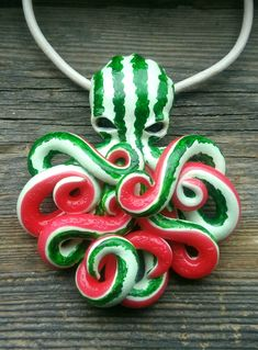 Mini version of watermelon octopus pendant 🍉 Color of this octo - watermelon peel, suckers on tentacles - red like pulp of watermelon. Unique jewelry with bright cutie. Cute Polymer Clay, Cute Clay, Polymer Clay Charms, Diy Clay, Polymer Clay Jewelry, Clay Crafts, Polymer Clay Sculptures, Sculpture Clay, Clay Monsters