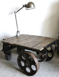Old factory trolley + original Jielde lamp http://www.sovintage.co.nz/stock/tables/industrial-factory-cart-wood-metal-detail