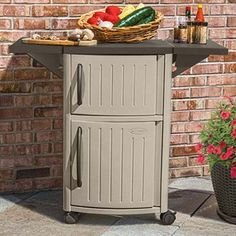 The Suncast Serving Station Patio Cabinet is an essential solution for outdoor entertaining. Durable resin construction makes the Serving Station Patio Cabinet ideal for year-round u Outdoor Bar Sets, Outdoor Decor, Patio Storage, Serving Cart, Grill Accessories, Patio Bar, Countertop Materials, Outdoor Entertaining, Outdoor Grilling