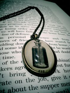 A special little find -- pendent with perfume bottle #opticmusings