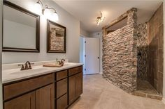 Beautiful bathroom with stone walk-in shower.