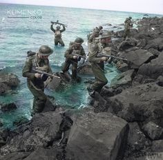 Men of Oxfordshire and Buckinghamshire Light Infantry clamber over rocks, having swum ashore during 'toughening up' exercises by the sea at Castlerock in Northern Ireland, 14 July British Armed Forces, British Soldier, British Army, Ww2 History, Military History, Ww2 Photos, Ww2 Pictures, Commonwealth, Marine Commandos