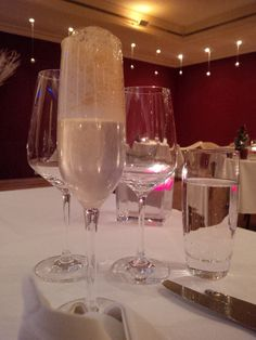 Champagne with an orange ginger bread espuma @ Restaurant Baccara