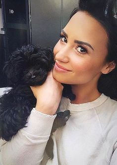 "After losing her Maltese mix Buddy in a tragic accident in July, Demi finally took the leap on her 23rd birthday and got another dog to keep her company while she tours promoting her new single, ""Cool For the Summer."" Her little black puppy's name is Batman, and he's already the star of Demi's Instagram account."