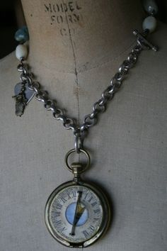 This is such an amazing old compass and dangles from a heavy sterling silver chain. Large semi precious gemstones and mother of pearl beads add a great mix of texture to this necklace. A sterling heart hangs from the side along with a name charm. This piece measures approx.17 in length.
