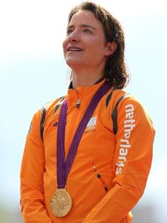 Gold medallist Marianne Vos of Netherlands poses with the gold medal in the Victory Ceremony after the women's Road Race Road Cycling on Day 2 of the London 2012 Olympic Games.