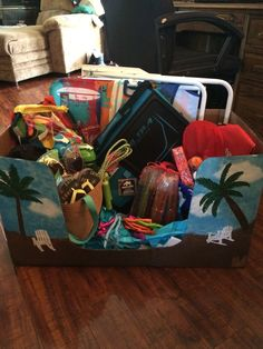 Beach theme box for family fun night silent auction. I painted the box and added donated and bought items. I added an umbrella and other beach items also.