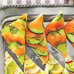 Salmon and cucumber make for a refreshing and delicious pairing in Salmon-Cucumber Tea Sandwiches. Make pretty mosaics with these tea sandwiches with our all-purpose cream cheese spread and layering method.