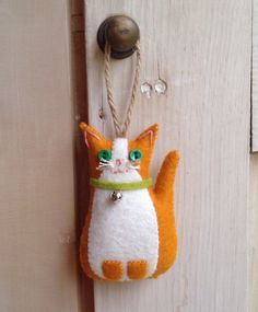 A personal favourite from my Etsy shop https://www.etsy.com/uk/listing/270189933/hanging-felt-little-ginger-cat