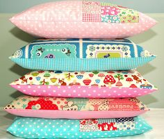 Stack of kids pillows by Holland Fabric House, via Flickr