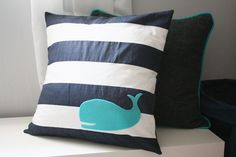 """Having a """"whale of a time"""" with these pillows. I'm pretty sure they are for a baby's room.  But I kinda want them."""