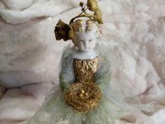 Woman holding gold bird nest - figurine - Charlene Geiger Designs -- (pretty bits 'n bobs)