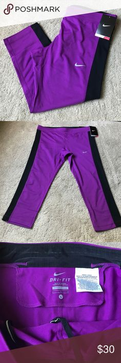 NWT!! Nike Capri's! NWT! Purple and black Nike capris. Tight fit. Mesh on the back built in pocket in the waistband. Great for any adventure! Nike Pants Capris