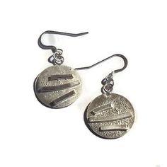 Line patterned sterling silver disc earrings £40.00