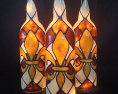 This Signature Series Bottle comes coated in brushed metallic gold with your choice of a red, black or bronze fleur de lis. This listing is for one Signature Fleur De Lis bottle.