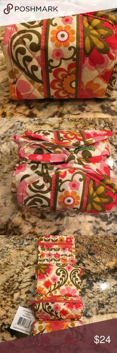 Vera Bradley Jewelry Case Beautiful brand New with ticket, Vera Bradley travel jewelry case in Folkloric pattern with many compartments to tuck your favorite jewelry pieces in. Case has magnet in it that allows it to neatly roll up. Vera Bradley Bags Travel Bags