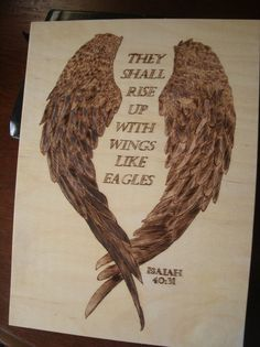 """Hand burned in wonderful detail, each feather on these georgous wings looks individually crafted to frame the beautiful quote from Isaiah 40. """"They shall rise up with wings like eagles."""""""