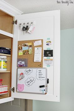 Hang a handy cork board - $6 - The back of a cabinet offers a convenient spot to create a small command center. See more cabinet organizing tips at HouseBeautiful.com.
