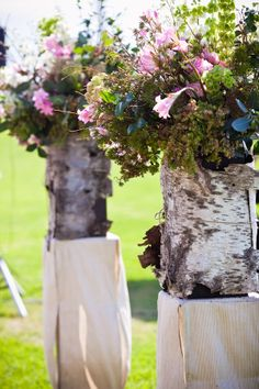 Tree-trunks as flower-arrangement stands! (#pink weddings, #rustic weddings)