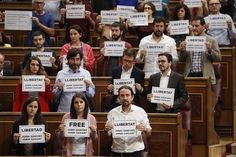 Madrid, Spain Unidos Podemos MP's hold banners in support of pro-independence leaders from the Catalonian national assembly who have been imprisoned