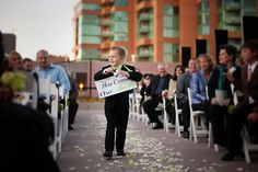 our ring bearer Connor, ringing the bell & carrying a 'here comes the bride' sign