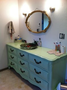 restored an old dresser to a new bathroom vanity...seafoam green paint job with a clear varnish on top with a dropped-in vessel sink.