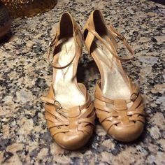Vince Camuto kitten heeled strappy shoes Butterscotch colored Vince Camuto kitten heels.   Woven straps over toes of shoe.   Adjustable ankle strap.  Nice condition. Vince Camuto Shoes Heels