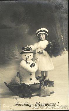 Vintage postcard - Girl with  studio Snowman