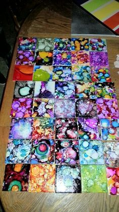 Alcohol ink coaster. Just plain while ceramic tiles, rubbing alcohol and special alcohol ink from any craft store. Would make an awesome new bathroom floor!