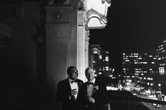 Love the city in the background in this timeless picture | Real Wedding: Gary Ireland and Gilbert Archuleta | Photo by: James Moes | Seattle Met Bride and Groom W/S 13
