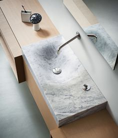 815 Washbasin by Benedini Associati for Agape Design The asymmetrical form of Agape's Cararra marble sink is modeled after the effect of ...