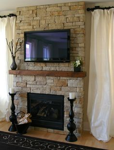 I like the simple mantle, if it were a bit wider. The lack of hearth gives space for tv, and possibly a built in box underneath to hide the centre channel/ play station. I could go with no stone above mantle to save costs. Colors are good.