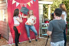 Carnival themed photo booth? ( I could set up my camera with the tripod and clicker! Then we can create a site for people to download their pictures and print!)