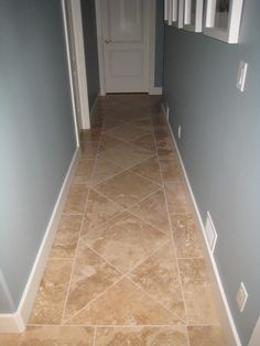 custom floor tile installation is a great example of how the same tile can look different just from placement degree angle) . Flooring, House Design, Travertine Floor Tile, Floor Tile Design, Tiled Hallway, Home Remodeling, Travertine Floors, House Flooring, Custom Floor Tile