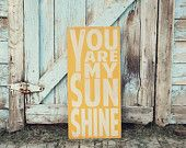 You Are My Sunshine Sign Typography Word Art in Rainbow Colors Heavily Distressed. $100.00, via Etsy.