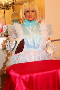Sissy maid working very hard and doing the Ironing of a red satin robe
