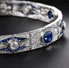 This exquisite original Art Deco bracelet is hand fabricated in platinum and features a highly decorative repeating geometric pattern that is quintessential chic. The bracelet is 7 inches long and inch wide and features five electric-blue sa Art Deco Jewelry, Modern Jewelry, Fine Jewelry, Jewelry Design, Armband Vintage, Art Deco Fashion, Fashion Jewelry, Antique Jewelry, Vintage Jewelry