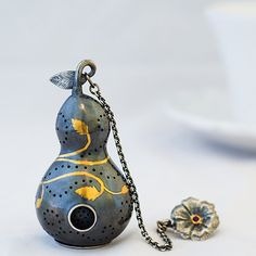 Museum-quality tea infusers, tea balls, and accessories