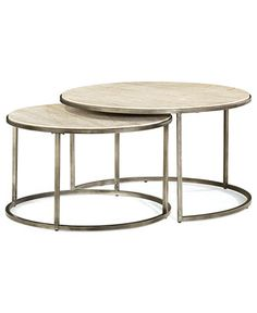 """Make your living space truly flexible with an edgy nesting design that features one large coffee table with a smaller table that slides in & out underneath. Refined Travertine marble tops in a perfectly circular silhuette juxtapose the textured, bronze-finished metal bases.      Coffee table dimensions: 36""""DIA x 20""""H     Nesting table dimensions: 30""""DIA x 17.5""""H Monterey Coffee Table, Round Nesting - Furniture - Macy's"""