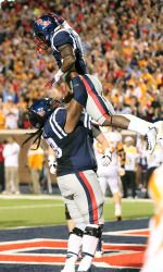 Justin Bell and Jaylen Walton celebrate a touchdown in the 34-3 win over Tennessee. (photo by Joshua McCoy)