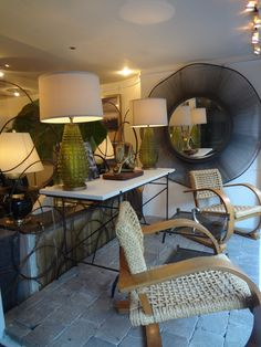 Woven #chairs with round #iron #mirror window display at #NewYork #Mecox #interiordesign #NYC #MecoxGardens #furniture #shopping #home #decor #design #room #designidea #vintage #antiques #garden