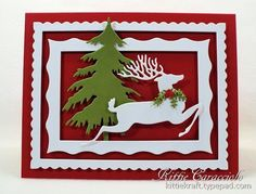 handmade Christmas card: KC Impression Obsession Reindeer ... all die cuts .... deep red base card .. two white decorative frames ... white stag ... luv the sharp, clean lines from die cuts ... nice dimenssion betwee the pieces ...