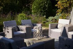 Outdoor seating in the subtropical garden at Coral Beach House in Angmering-On-Sea, West Sussex.