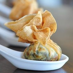 Spinach, ricotta, and cream cheese in a crispy wonton pouch