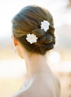 love this updo + flower accent // photo by Ali Harper