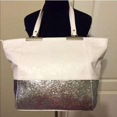 """NWT White Faux Leather/Silver glitter Tote Bag! Just in time for Spring! NWT! Inside has zip pocket and two slip pockets. Zip top closure. Large tote. 19""""W at top, 12""""W at bottom, 12""""L, 10"""" handle drop. Good for everything and SO pretty!! Must have! Take to pool or beach!! Bags Totes"""
