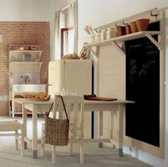 cuisine de style campagne avec table à manger en bois et chaises