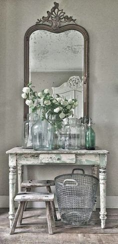 Group vintage table, mirror, old bottles, baskets and add fresh flowers for lovely display. Nice way to use odd pieces stored away or show case a small collection of depression glass! #shabbychicdecorcottage